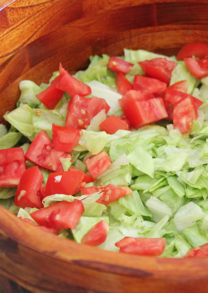 The first layers of the salad. These were really purrty tomatoes. I used romas but you could use whatever looks good. If you are making this in the winter and tomatoes are unavailable where you live, you could sub canned diced tomatoes.